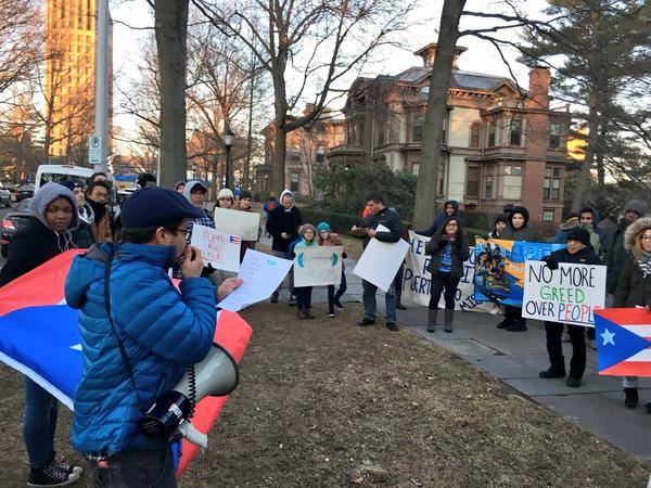 Advocates from Make the Road CT lead dozens of people in protest at Yale on Thursday. The group is calling for the university to divest from Baupost, a hedge fund that owns almost $1 billion of Puerto Rico's debt.