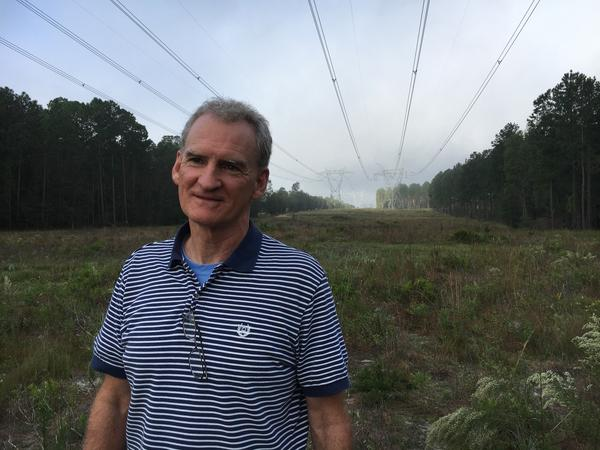 Georgia Power wildlife biologist Jim Ozier, standing under transmission lines running from Plant Hatch. The areas under power lines are good for plants and animals that need sun, Ozier says.