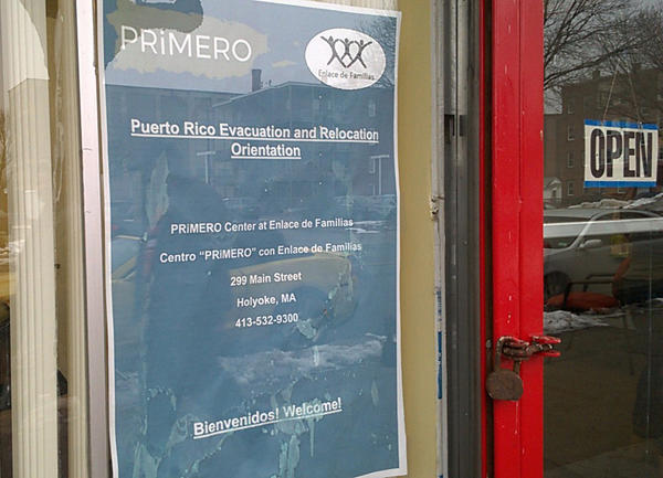 "A sign in the window at Enlace de Familias in Holyoke, Massachusetts, one of 22 ""welcome centers"" in the state for evacuees from Puerto Rico."
