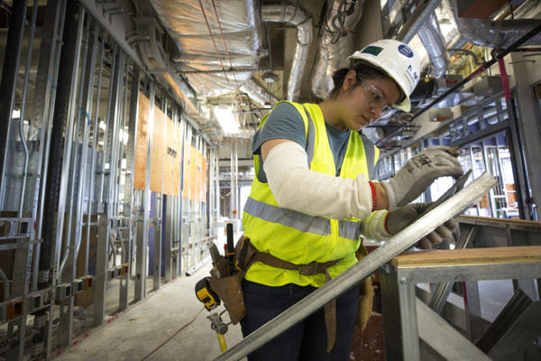 Cynthia Tercero works at a building site at the Texas Medical Center in Houston. Finding gloves that fit is often a challenge for women in construction trades.