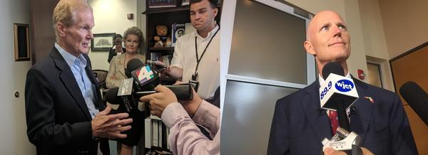 Nelson (left) and Scott (right) talk to reporters.