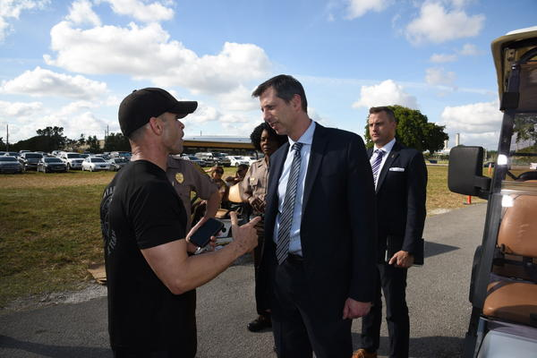 James Walsh (center), Deputy Assistant Secretary of State for the Bureau of International Narcotics and Law Enforcement Affairs, meetig with Miami-Dade police this week.