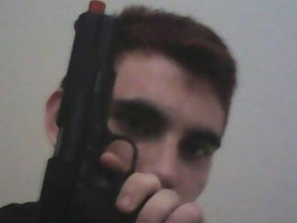 Confessed Parkland school shooter Nikolas Cruz waving a pistol in a recent Instagram post.
