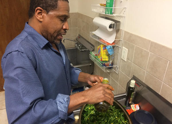 Boyzell Hosey, co-founder of the Tampa Bay Collard Green Festival, prepares some of his greens during a friendly cook-off at Bethel Community Baptist Church.