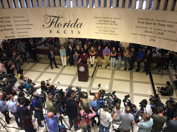 Students from Marjory Stoneman Douglas High speak to the media inside the Florida capitol.