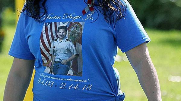 A mourner wears a T-shirt in tribute to Martin Duque, a victim of the shooting at Marjory Stoneman Douglas Senior High at his funeral on Sunday, Feb. 25, 2018.