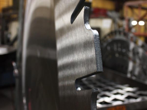 The finished edge of a saw blade produced by Simonds International in Big Rapids, Mich. The blades require steel not available from U.S. mills.