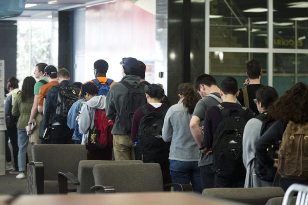 Voters line up to cast ballots at the Flawn Academic Center on the UT Austin campus on Tuesday.
