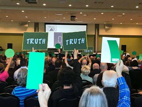 People attending Tuesday's hearing were asked to wave green signs to support an issue, red to oppose.