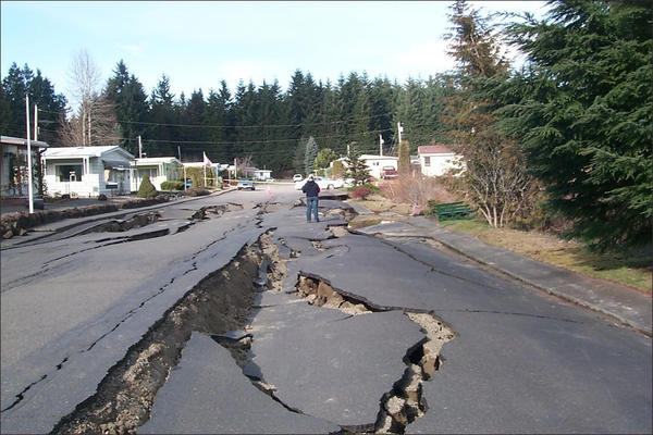 Road damage due to liquefaction from the 2001 Nisqually Earthquake in Thurston County, Washington. Liquefaction is when the soil turns to jello during intense shaking.