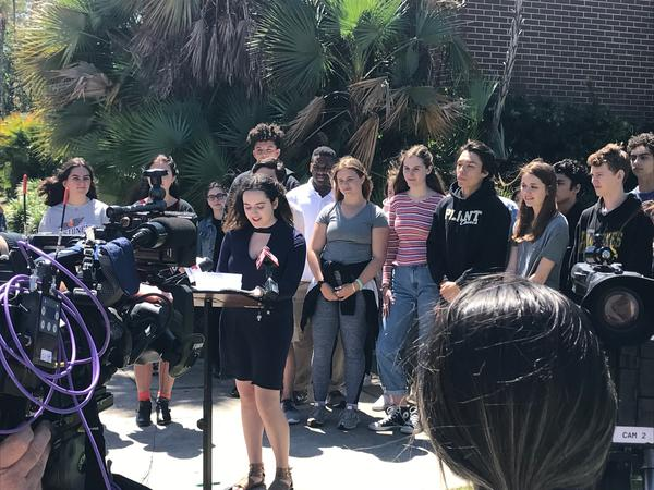 "Henry B. Plant High School students at a press conference Saturday. Senior Macie Lavender, who was one of a hundful of students to speak, urged fellow students to transformed a tragedy into a passion to do the ""impossible."""