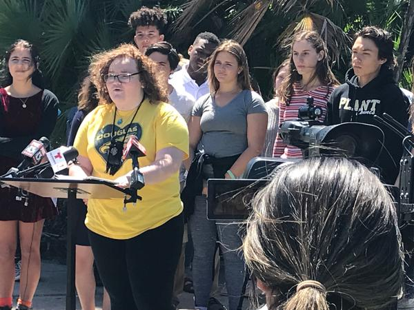Bella Cruz-O'Grady from Steinbrenner High School addresses reporters to promote Saturday's March For Our Lives