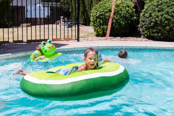 """Landon Morris plays in the pool with his brothers. """"He runs and jumps and wrestles with his brothers,"""" says his mom, Jessica Morris."""