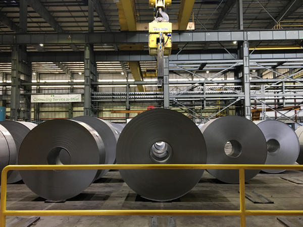 Rows of imported steel coil from Australia and Japan are lined up on the assembly line at Steelscape in Kalama, Washington. The company imports raw materials and turns them into galvanized steel used on building exteriors and for large appliances.