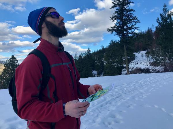 Study co-author Philip Higuera holding a burn severity map near Lolo, Montana.