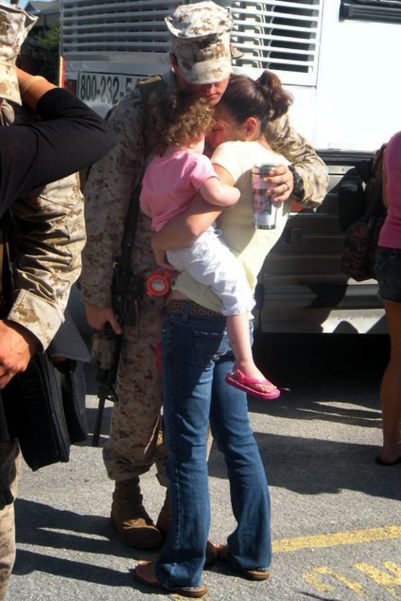 Thomas with his Mel and daughter Maddie on the day he deployed to Afghanistan in mid-2010.