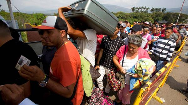 Venezuelans fleeing their country's economic and political catastrophe pour across the border into Colombia last month.