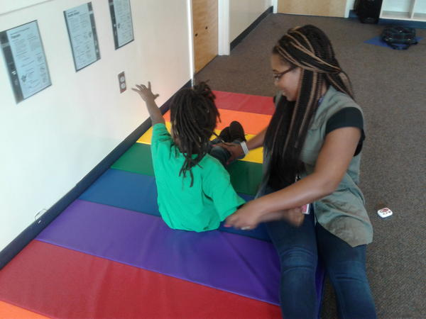 Irvin Elementary behavior coach Annessia Lee works with student in the Ready Body Lab