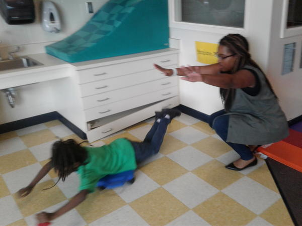 Irvin Elementary behavior coach Annessia Lee helps student let off steam while learing in the Ready Body Lab