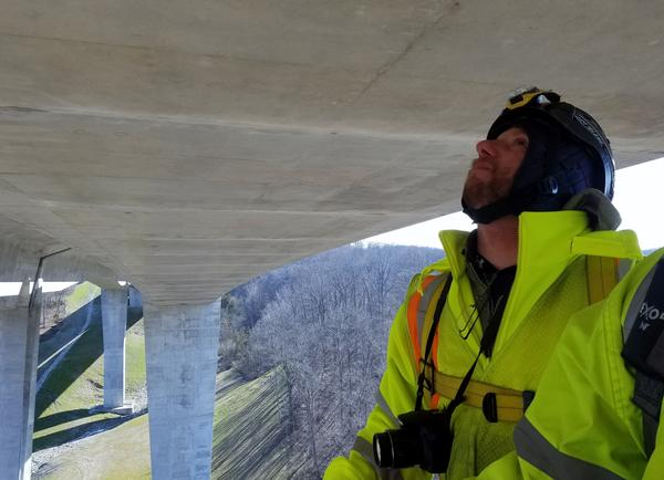 Bridge Specialist David Krazl inspects the bottom of the Jeremiah Morrow Bridge from a snooper truck basket some 200 feet above the Little Miami River.