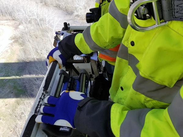 Bridge Specialist Jared Backs uses a series of controllers to raise. lower and swivel the snooper's passenger basket.