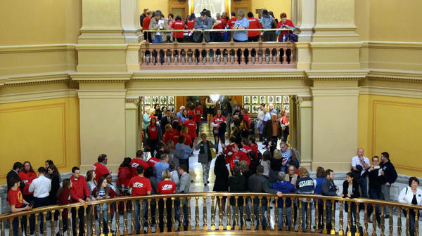 Members of the state's largest teachers union came to the Statehouse Saturday evening to lobby for more school spending.