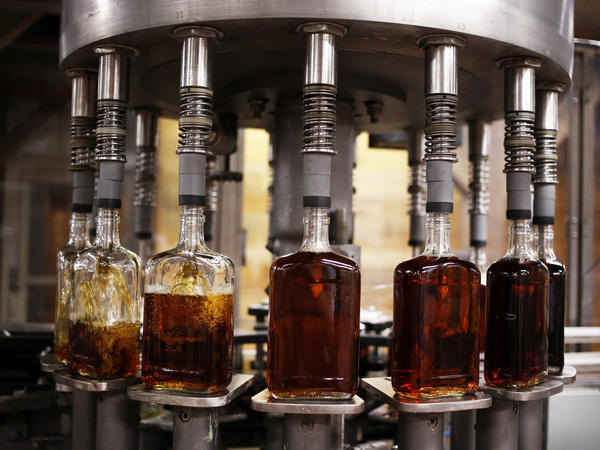 Bottles of single barrel bourbon are filled on the bottling line at a distillery in Kentucky, the center of the bourbon universe. But some distillers are looking to other spirits, too.