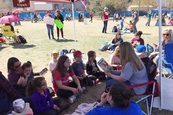 Teachers from Blanchard read to students on Capitol grounds on Tuesday, April 10, 2018.