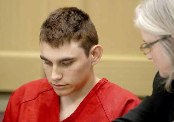 In this Feb. 19, 2018 file photo, Nikolas Cruz, accused of murdering 17 people in the Florida high school shooting, appears in court for a status hearing in Fort Lauderdale, Fla.
