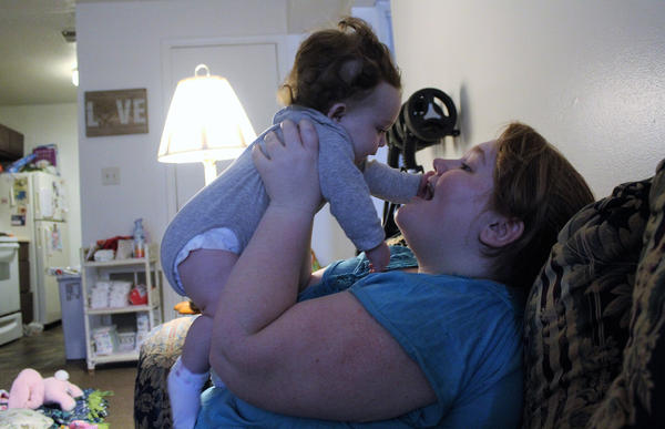Aubri Thompson says she still struggles with transportation and affordable day care for her 6-month-old daughter, Rinleigh. She has found support through YouThrive, a program that pairs former foster care youths with families.