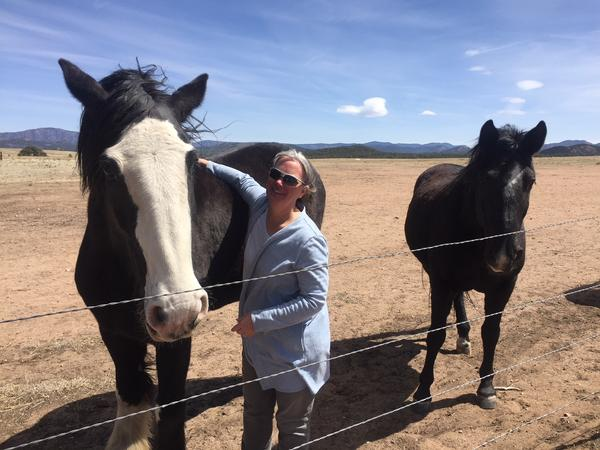 Kate Vickery at home with two of her horses