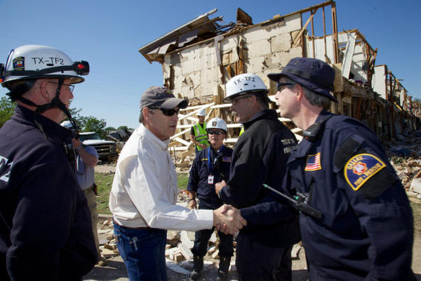 Former Governor Rick Perry with first responders in West in 2013.