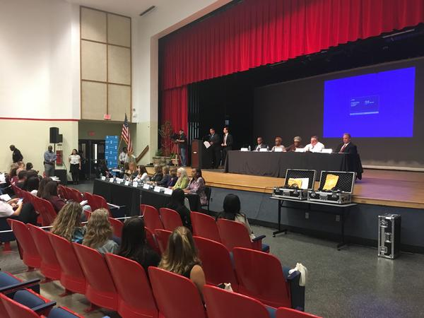 Superintendent Robert Runcie and district administrators answered questions on stage while the school board sat quietly in front.