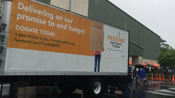 Feeding Northeast Florida's mobile food pantry provided free food to hundreds of people in the 32254-56 zip codes area.