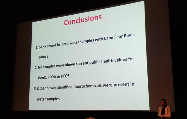 Nadine Kotlarz (lower right) concludes her remarks on the tap water test results.
