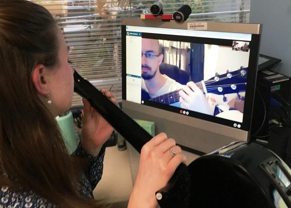 Diane Garrison Langston, a board-certified music therapist at the Gainesville VA, is teaching Joshua Lawhorn guitar to help with his symptoms due to post traumatic stress and traumatic brain injury.