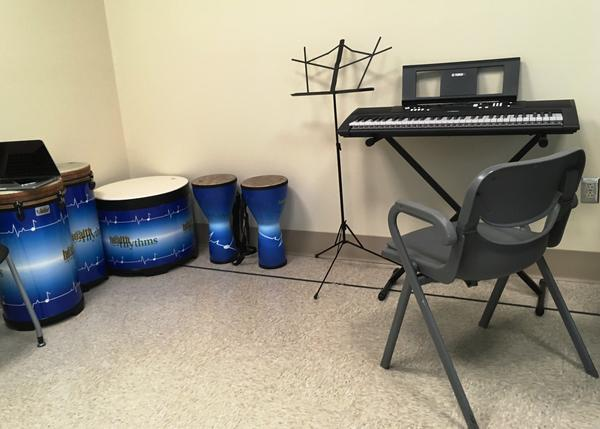 Guitar isn't the only instrument used in the music therapy program, there are drums and keyboard as well.