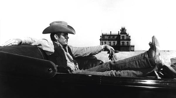 James Dean on the set of the 1956 film <em>Giant</em>, which was filmed on the Ryan Ranch, west of the town of Marfa. The skeleton of the mansion in the background still stands on the ranch today.