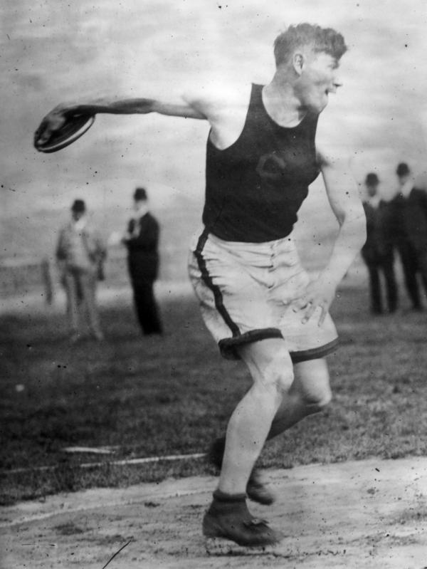 Native American sports star Jim Thorpe throws the discus at the 1912 Olympics in Stockholm, where he won gold medals in both the pentathlon and decathlon events.