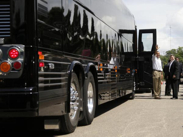 <strong>Bus Stop:</strong> President Obama waves before boarding his bus after having lunch and greeting people at The Old Market Deli on Monday,  in Cannon Falls, Minn., during his three-day economic bus tour.