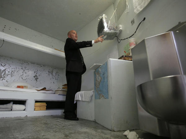 Correctional Officer Lt. Christopher Acosta  turns on a television in a cell in the Secure Housing Unit at Pelican Bay State Prison near Crescent City, Calif., on Aug. 17.  State prison officials allowed the media to tour Pelican Bay's SHU, where inmates are isolated.
