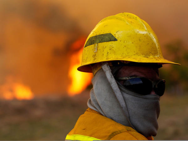 Volunteer firefighter Jason Collard at a wildfire in Strawn, Texas, in April.