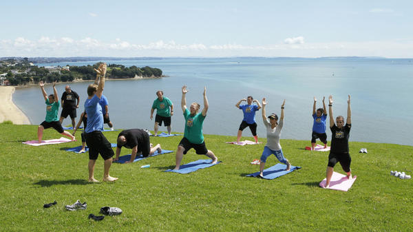 """Contestants from NBC's """"The Biggest Loser"""" do yoga in Auckland, New Zealand."""