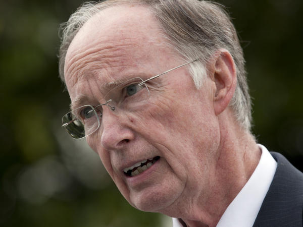 Gov. Robert Bentley talks with reporters outside the Capitol in Montgomery, Ala.,  on Wednesday. Bentley said he will work with the state attorney general to appeal the parts of the decision that struck down sections of the state's illegal immigrant law.