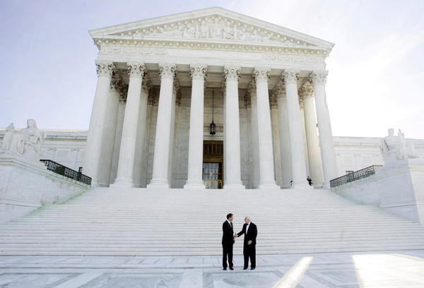 <p>Justice John Paul Stevens (right) stands with newly sworn-in Chief Justice John Roberts in front of the U.S. Supreme Court in October 2005. Stevens' new book, <em>Five Chiefs,</em> is a discussion about the office of chief justice, featuring detailed profiles of the five Stevens knew well: Fred Vinson, Earl Warren, Warren Burger, William Rehnquist and John Roberts.</p>