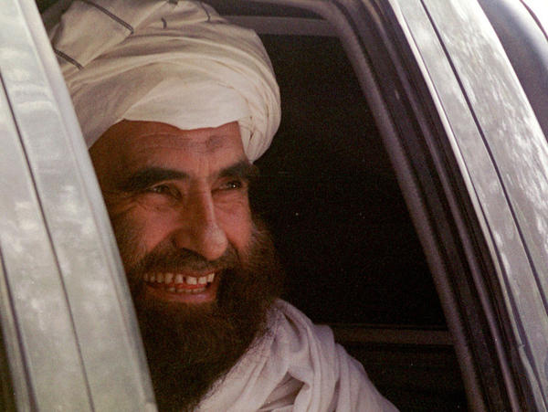 "<p>In this archive photo from October 21, 2001, Jalaluddin Haqqani smiles as he leaves after a meeting with Jama""at-i-Islami leaders in Islamabad, Pakistan.</p>"