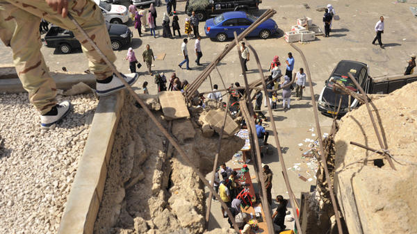 <p>Libyans visit the destroyed Bab al-Azizia military barracks and compound of their country's ousted leader Moammar Gadhafi, in the southern suburbs of Tripoli, Libya.</p>
