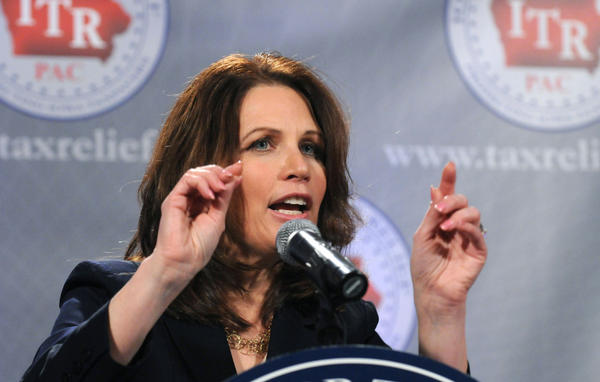 <p>Rep. Michele Bachmann, shown speaking at a reception by the anti-tax group Iowans for Tax Relief, was once a prosecutor for the IRS. On the campaign trail, she has made that part of her resume a selling point. </p>