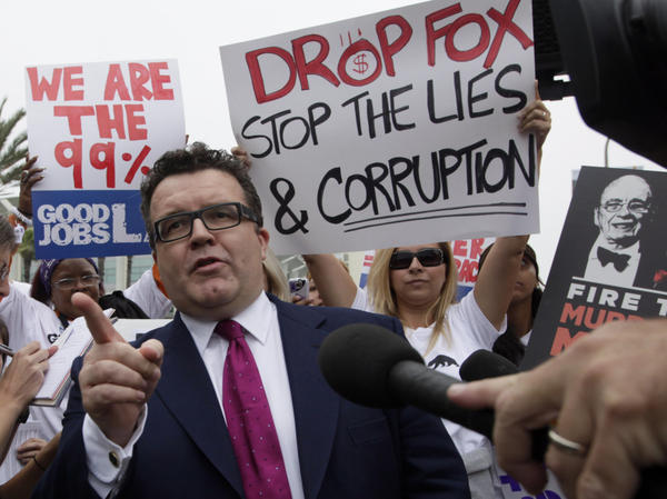 <p>British lawmaker Tom Watson, who is leading the investigative charge into the News Corp. hacking scandal, talks to protesters outside Fox Studios.</p>