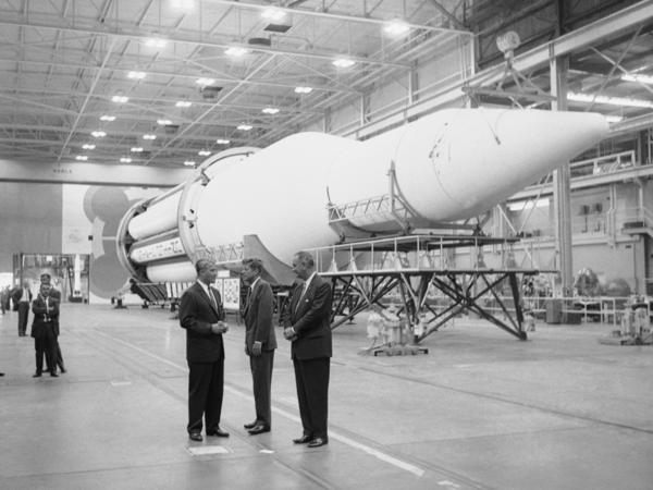 In 1962, President John Kennedy (center) and Vice President Lyndon Johnson visited Dr. Wernher von Braun (left), who designed the Saturn rocket in Huntsville, Ala.